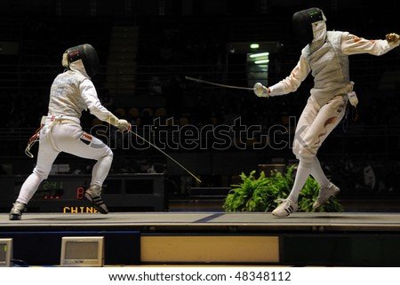 TURIN - FEB 7:  Women Foil World Cup, Chinese fencer LE Huilin fight against german fencer GOLUBYTSKYI Carolin during semifinal match of team tournament on  February 7, 2010 in Turin, Italy.
