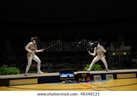 TURIN - FEB 7: Women Foil World Cup, Chinese fencer LE Huilin fight against german fencer WACHTER Katja during semifinal match of team tournament on  February 7, 2010 in Turin, Italy.