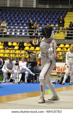 TURIN, FEB 6: Women Foil World Cup, fencer BRYARS Hannah (Great Britain) stands on ward during tournament on  February 6, 2010 in Turin, Italy.
