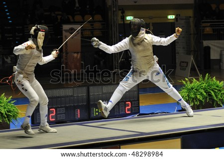 TURIN, FEB 6: Women Foil World Cup, Korean fencer NAM Hyun Hee fight against Italian fencer DURANDO Benedetta during semifinal match on  February 6, 2010 in Turin, Italy. - stock photo