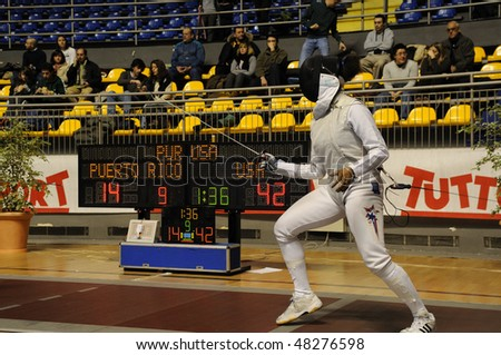 TURIN - FEB 7: Women Foil World Cup, Usa fencer PRESCOD Nzingha on ward during team tournament on  February 7, 2010 in Turin, Italy.