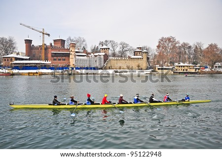 """TURIN - FEBRUARY 12: Medieval Village, Park of Valentino, an unidentified crew during the traditional International long distance rowing regatta """"D'inverno sul Po"""" on February 12, 2012"""