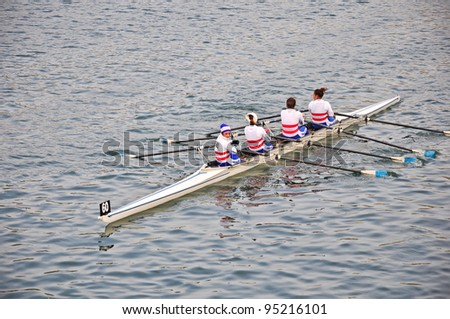 "TURIN - FEBRUARY 12: River Po, an unidentified crew during the traditional International long distance rowing regatta ""D'inverno sul Po"" on February 12, 2012 Turin, Italy."