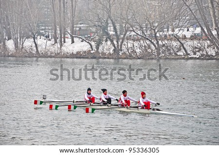 """TURIN - FEBRUARY 12: River Po, Park of Valentino, an unidentified crew during the traditional International long distance rowing regatta """"D'inverno sul Po"""" on February 12, 2012 Turin, Italy."""