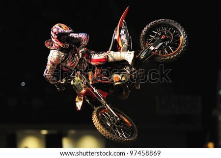 TURIN, ITALY - FEB 03: Massimiliano BIANCONCINI (ITA) performs trick during the 2012 FIM Mx Freestyle World Championship on February 03, 2012 in Turin, Italy.