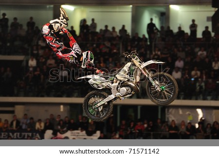 TURIN, ITALY - FEB 20: Remi BIZOUARD (FRA) performs a one hand grab trick during the 2011 IFMX Freestyle motocross world championship on February 20, 2011 in Turin, Italy.