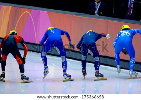 TURIN, ITALY FEBRUARY 13, 2006: Athletes group at the start line during the Short Track competition at the Winter Olympic Games of Turin 2006.