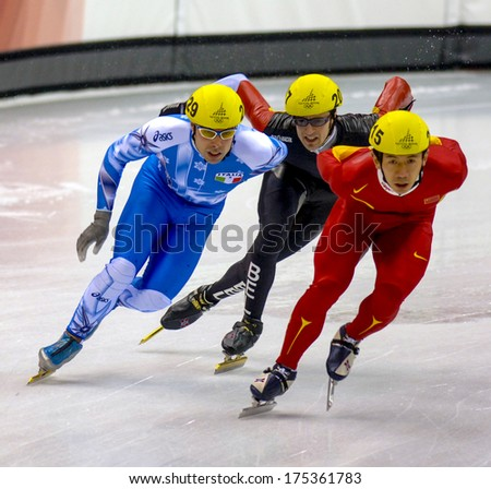 TURIN, ITALY FEBRUARY 16, 2006: Athletes group during the Short Track competition at the Winter Olympic Games of Turin 2006.