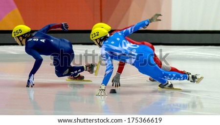 TURIN, ITALY FEBRUARY 06, 2006: Athletes group during the Short Track competition at the Winter Olympic Games of Turin 2006.