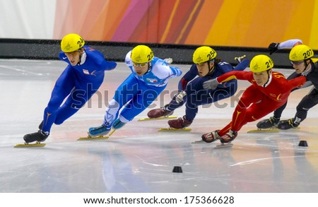 TURIN, ITALY FEBRUARY 13, 2006: Athletes group during the Short Track competition at the Winter Olympic Games of Turin 2006.