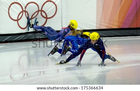TURIN, ITALY FEBRUARY 196 2006: Athletes group during the Short Track competition at the Winter Olympic Games of Turin 2006.