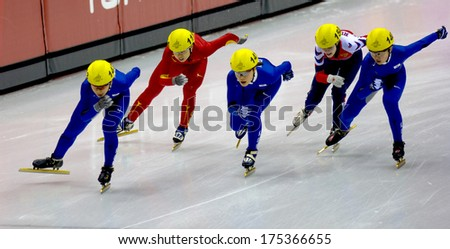 TURIN, ITALY FEBRUARY 19, 2006: Athletes group during the Short Track competition at the Winter Olympic Games of Turin 2006.