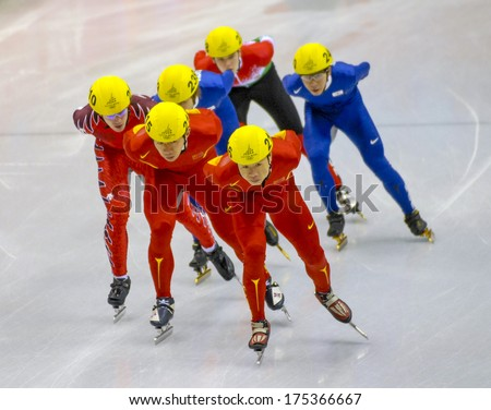 TURIN, ITALY FEBRUARY 08, 2006: Athletes group during the Short Track competition at the Winter Olympic Games of Turin 2006.