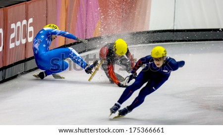 TURIN, ITALY FEBRUARY 16, 2006: Athletes group falling during the Short Track competition at the Winter Olympic Games of Turin 2006.