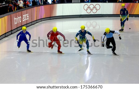 TURIN, ITALY FEBRUARY 16, 2006: Athletes group starting during the Short Track competition at the Winter Olympic Games of Turin 2006.