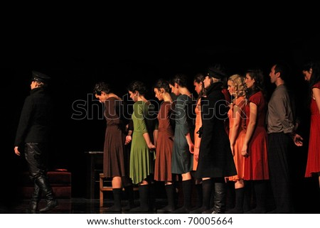 "TURIN, ITALY - JANUARY 25: dancers perform ""The diary of Anna Frank"", on January, 25, 2011 in ""Lavanderia a Vapore theater"", in  Turin, Italy. The dancers belongs to Ballet Company of Salvino Aiosa."