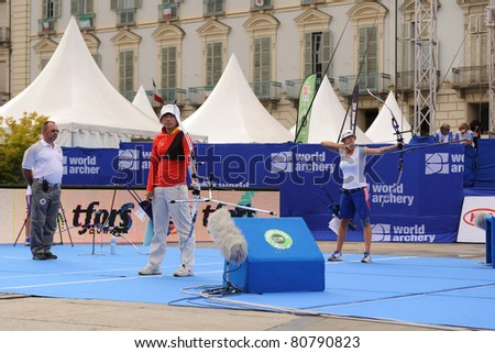 TURIN, ITALY - JULY 10: FANG Yuting (CHN) left SCHUH Berengere (FRA) right compete at bronze round women recurve 2011 World Archery and Para Archery Championships , on June 10, 2011 in Turin, Italy.