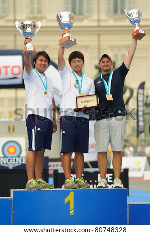 TURIN, ITALY - JULY 10: from left OH Jin Hyek (KOR) KIM Woojin (KOR)ELLISON Brady (USA) stands at podium at the 2011 World Archery and Para Archery Championships, on June 10, 2011 in Turin, Italy.