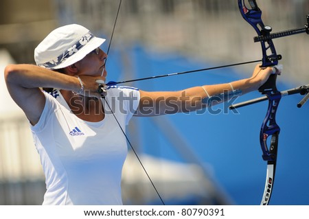 TURIN, ITALY - JULY 10: SCHUH Berengere (FRA) competes at round for bronze at 2011 World Archery and Para Archery Championships , on June 10, 2011 in Turin, Italy.