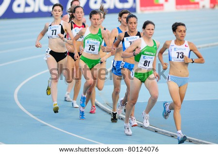 TURIN, ITALY - JUNE 26: Agne Tschurtschenthaler (No. 81) and Martina Facciani (No. 73) lead the pack during 5,000m women's race at 2011 Track and Field Italian Championship on June 26, 2011 in Turin, Italy.