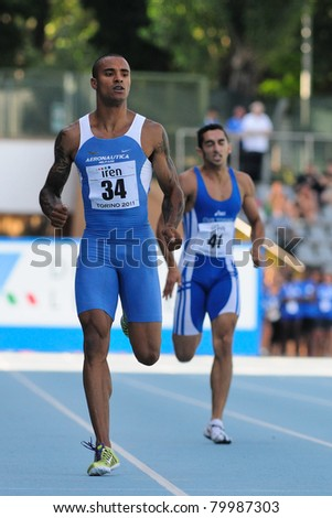 TURIN, ITALY - JUNE 26: Andrew Howe, the 2011 Italian champion, runs at 200m mens sprint race during the 2011 Summer Track and Field Italian Championship meeting on June 26, 2011 in Turin, Italy.