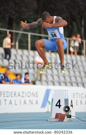 TURIN, ITALY - JUNE 26: Andrew Howe, the 2011 Italian champion, warms up before 200m mens sprint during the 2011 Summer Track and Field Italian Championship meeting on June 26, 2011 in Turin, Italy.