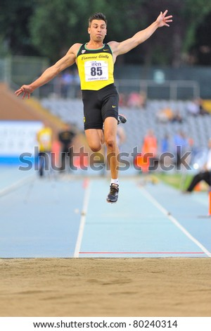 TURIN, ITALY - JUNE 25: CATANIA Emanuele performs a long jump during the 2011 Summer Track and Field Italian Championship meeting on June 25, 2011 in Turin, Italy.