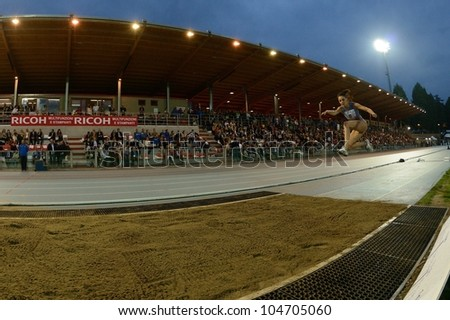 TURIN, ITALY - JUNE 08: Eleonora D'Elicio ITA performs triple jump during the International Track & Field meeting Memorial Nebiolo 2012 on June 08, 2012 in Turin, Italy.