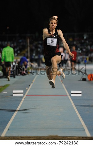 TURIN, ITALY - JUNE 10: Fedorov Aleksey (RUS) performs triple jump during the 2011 Memorial Primo Nebiolo track and field athletics international meeting, on June 10, 2011 in Turin, Italy.