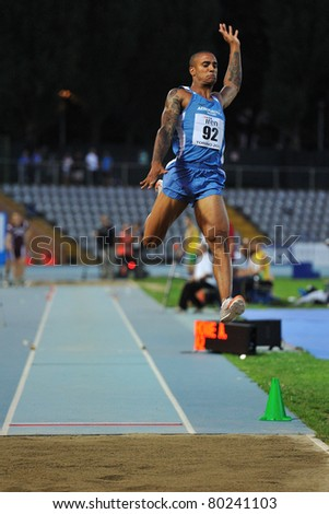 TURIN, ITALY - JUNE 25: HOWE Andrew performs a long jump during the 2011 Summer Track and Field Italian Championship meeting on June 25, 2011 in Turin, Italy.