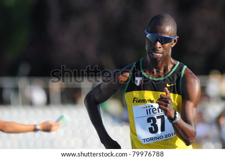 TURIN, ITALY - JUNE 25: Jean Jacque Nkouloukidi, the 2011 Italian 10 km champion, competes in the 10 km walk during the 2011 Summer Track and Field Italian Championship meeting on June 25, 2011 in Turin, Italy.