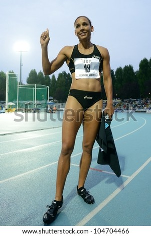 TURIN, ITALY - JUNE 08: Lori Lolo Jones USA cheers after winning 110m HS sprint race during the International Track & Field meeting Memorial Nebiolo 2012 on June 08, 2012 in Turin, Italy - stock photo