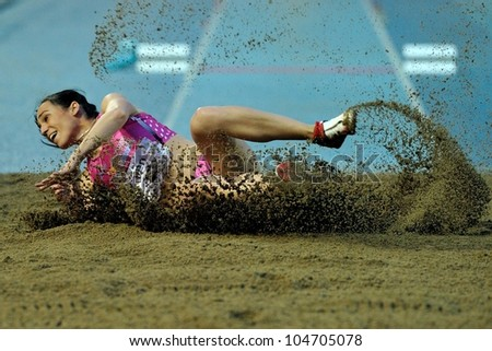 TURIN, ITALY - JUNE 08: Patricia Sarrapio ESP performs triple jump during the International Track & Field meeting Memorial Nebiolo 2012 on June 08, 2012 in Turin, Italy.