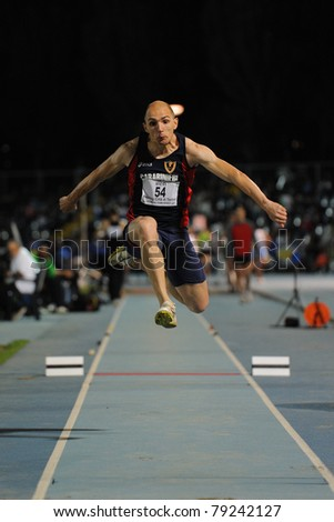 TURIN, ITALY - JUNE 10: Schembri Fabrizio (ITA) performs triple jump during the 2011 Memorial Primo Nebiolo track and field athletics international meeting, on June 10, 2011 in Turin, Italy.