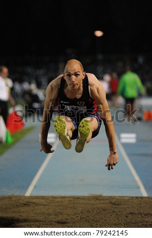 TURIN, ITALY - JUNE 10: Schembri Fabrizio (ITA) performs triple jump during the 2011 Memorial Primo Nebiolo track and field athletics international meeting, on June 10, 2011 in Turin, Italy. - stock photo