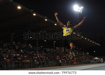TURIN, ITALY - JUNE 25: Stefano Dacastello a performs a long jump during the 2011 Summer Track and Field Italian Championship meeting on June 25, 2011 in Turin, Italy.