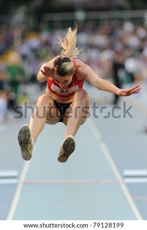 TURIN, ITALY - JUNE 10: Taranova Anastasia (RUS) performs triple jump during the 2011 Memorial Primo Nebiolo track and field athletics international meeting, on June 10, 2011 in Turin, Italy.