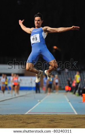TURIN, ITALY - JUNE 25: TREMIGLIOZZI Stefano performs a long jump during the 2011 Summer Track and Field Italian Championship meeting on June 25, 2011 in Turin, Italy.