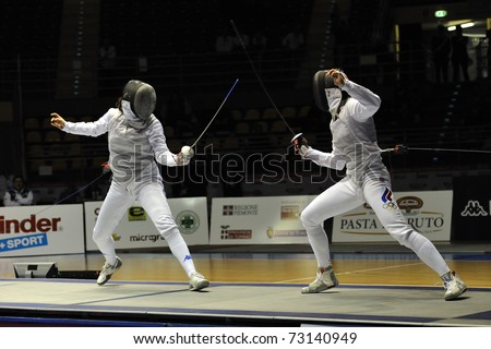 TURIN, ITALY - MARCH 13: Arianna ERRIGO (ITA) fight against SHANAEVA Aida (RUS) during team tournament final match of the 2011 Women world fencing cup on March 13, 2011 in Turin, Italy