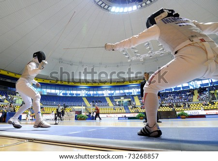 TURIN, ITALY - MARCH 13: IKEHATA Kanae (JAP) fight during team tournament final match of the 2011 Women world fencing cup on March 13, 2011 in Turin, Italy