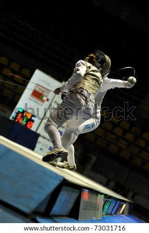 TURIN, ITALY - MARCH 12: Italian fencer Valentina VEZZALI fight against Arianna ERRIGO during final match of the 2011 Women world fencing cup on March 12, 2011 in Turin, Italy