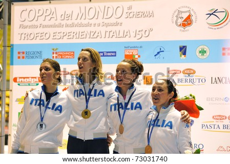 TURIN, ITALY - MARCH 12:  Italian fencers VEZZALI, DI FRANCISCA, ARRIGO and SALVATORI stand at podium the 2011 Women world fencing cup on March 12, 2011 in Turin, Italy
