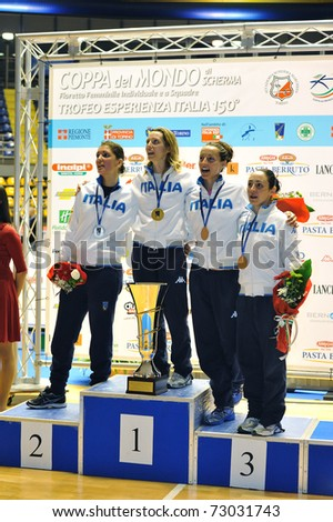 TURIN, ITALY - MARCH 12: Italian fencers VEZZALI, DI FRANCISCA, ARRIGO and SALVATORI stand at podium of the 2011 Women world fencing cup on March 12, 2011 in Turin, Italy
