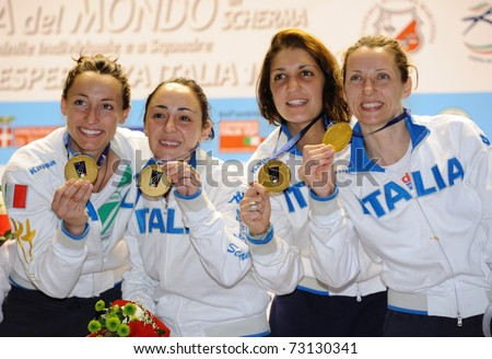 TURIN, ITALY - MARCH 13: Italy team (Di Francisca, Vezzali, Arrigo,  Salvatori) stands at first place podium of team tournament of the 2011 Women world fencing cup on March 13, 2011 in Turin, Italy