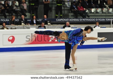 TURIN, ITALY - MARCH 23: Professional Chinese skaters Qing PANG Jian TONG perform Pair short program during the 2010 World Figure Skating Championship on March 23, 2010 in Turin, Italy.