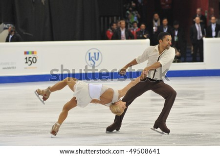 TURIN, ITALY - MARCH 24: Professional german skaters Aliona SAVCHENKO & Robin SZOLKOWY perform Pair free skating during the 2010 World Figure Skating Championship on March 24, 2010 in Turin, Italy.
