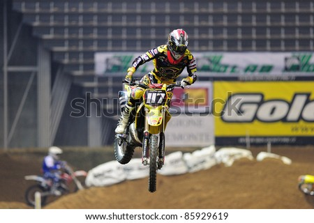 TURIN, ITALY - OCTOBER 01: BERGONZANI Ivan on Suzuky SX2 competes at Supercross SX series, on October 01, 2011 in Turin, Italy. SX Series is an important European indoor motocross championship.