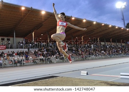 TURIN - JUNE 8: Pidluzhnaya Yuliya from Russia performs long jump woman at XIX Turin International Track and Field meeting, Italy on 8th june 2013, in Turin, Italy.