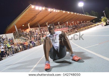 TURIN - JUNE 8:Robles Dayron from Cuba rest after 110m hurdles man race at XIX Turin International Track and Field meeting, Italy on 8th june 2013, in Turin, Italy. - stock photo