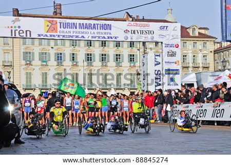 TURIN - NOVEMBER 13: Athletes on the starting line of the international competition Turin Marathon. November 13, 2011 Turin, Italy.